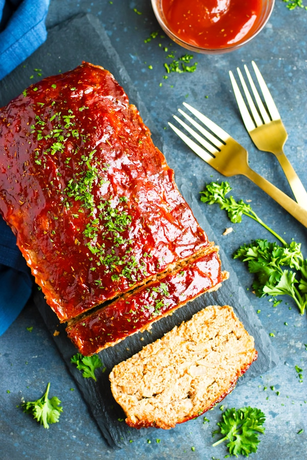 Paleo turkey meatloaf recipe on a slab with garnish.
