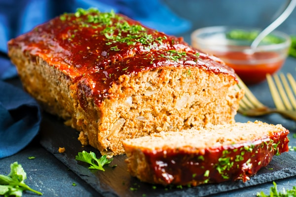 Gluten-free meatloaf with ground turkey on a slab for dinner.