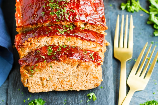 Paleo meatloaf on a table with two forks on the side.
