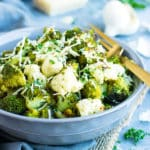 Parmesan Garlic Roasted Broccoli and Cauliflower | Roasted Broccoli and Cauliflower are accompanied by a delicious blend of garlic and Parmesan for a showstopping gluten-free side dish!  You can have this oven roasted broccoli-cauliflower recipe ready and on the table in under 30 minutes!