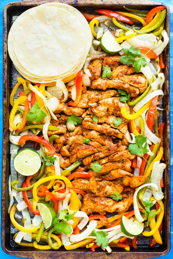 Oven-Baked Chicken Fajitas | Sheet Pan Chicken Fajitas are baked in the oven and ready to eat in under 45 minutes!  These oven-baked chicken fajitas make a great low-carb, gluten-free, dairy-free (and can easily be made Paleo!) weeknight dinner recipe the whole family will love!