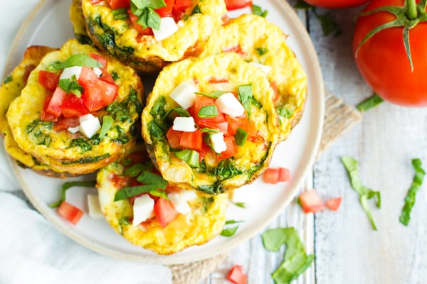 Healthy Spinach Egg Muffins with Tomatoes | Healthy Spinach Egg Muffins with Tomatoes are a great make-ahead low-carb, gluten-free, and keto breakfast recipe for those hectic weekday mornings.  Low-carb egg muffin cups are loaded with spinach, fresh mozzarella, and Roma tomatoes for the perfect grab-and-go breakfast!