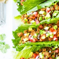 Ground Turkey Taco Lettuce Wraps | Ground Turkey Taco Lettuce Wraps are one of our favorite Paleo, Whole30, and keto recipes to make on a busy weeknight! Throw everything together in one skillet and these ground turkey lettuce wraps are ready in under 30 minutes!