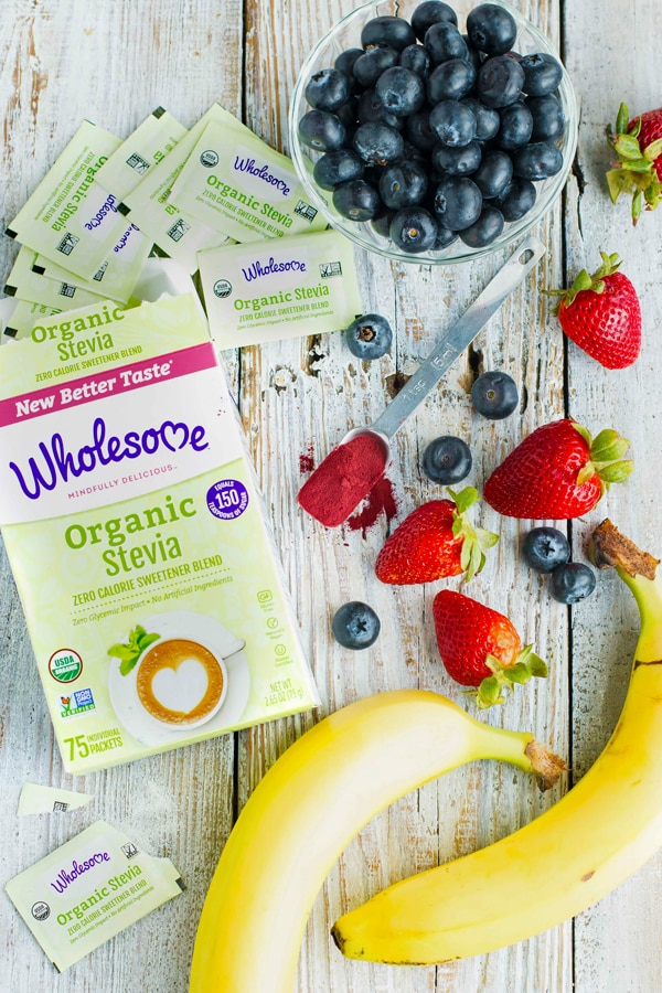 Wholesome Organic Stevia Package surrounded by berries and bananas.