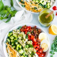 Healthy Chicken Cobb Salad | Prep ahead and enjoy this healthy chicken Cobb chopped kale salad for lunch or dinner! This chicken Cobb salad recipe is full of tomatoes, hard-boiled eggs, crispy bacon, Monterrey jack cheese, and chopped kale for a healthy, low-carb and gluten-free meal.