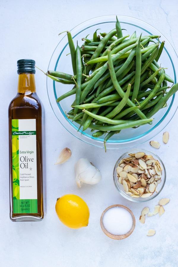 Oil, butter, garlic, lemon, sliced almonds, and fresh green beans.