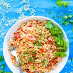Easy Instant Pot Mexican Rice | This easy Mexican rice recipe is one of the most flavorful and simplest to make Instant Pot rice recipes.  It is a delicious gluten-free, dairy-free, and soy-free side dish recipe that tastes great alongside chicken fajitas or tacos.