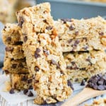 No Bake Peanut Butter Granola Bars are loaded with mini chocolate chips and salted peanuts.  This dairy-free, vegan, and gluten-free peanut butter chocolate chip granola bar recipe makes a great healthy afternoon snack the kids will love!