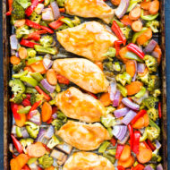 Sheet Pan Thai Peanut Chicken | Thai Peanut Butter Chicken and Veggies is an easy and healthy sheet pan dinner recipe that you can throw together on a busy weeknight!  Load up on lean chicken and nutritious veggies for a gluten-free, dairy-free, and low-carb meal the whole family will love!