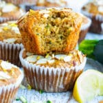 A picture of easy zucchini muffins with a whole zucchini on the side.