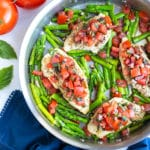 A 30-minute bruschetta chicken recipe made with basil, tomatoes, and asparagus in under 30 minutes.