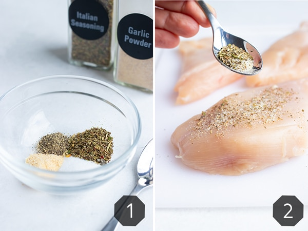 Sprinkling Italian seasoning on top of a chicken breast.
