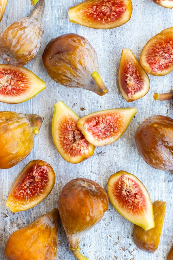 Fresh figs picked during fig season on a gray napkin.