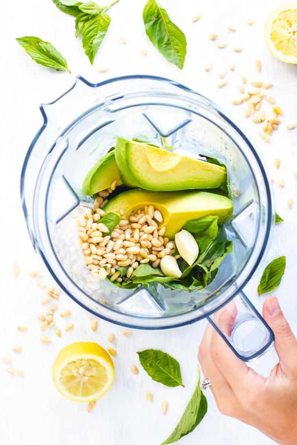 Ingredients for Vegan Avocado Pesto Recipe in a blender.