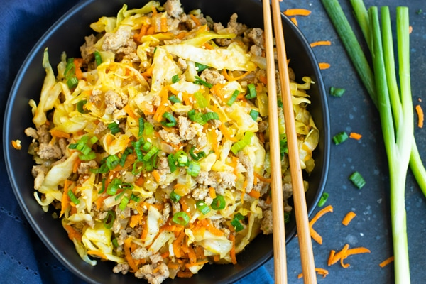 Paleo Egg Roll in a Bowl Recipe | This Egg Roll in a Bowl recipe is loaded with flavor and is a Paleo, Whole30, and keto recipe to make for an easy weeknight dinner.  From start to finish, you can have this healthy and low-carb dinner recipe ready in under 30 minutes! It's a super easy and healthy ground turkey dinner recipe!