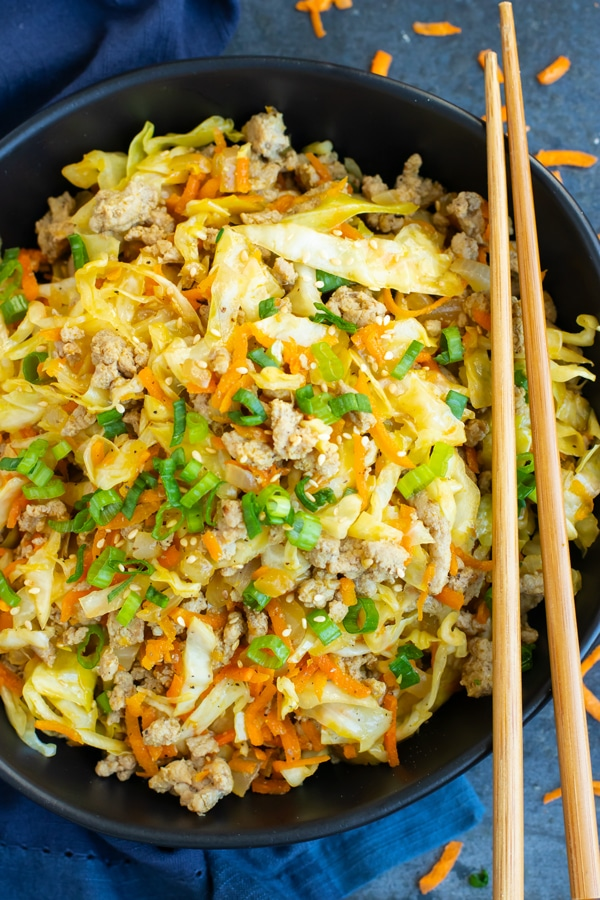 Easy Egg Roll in a Bowl Recipe in a black bowl with chopsticks.