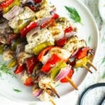 Easy Grilled Greek Chicken Shish Kabobs on a white plate for dinner.