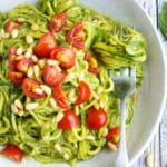Learn how to cook Zucchini Noodles with Pesto for a simple, low-carb, dairy-free, vegan, vegetarian, and ketogenic recipe that you can throw together for a healthy workday lunch or busy weeknight!  A vegan pesto recipe is combined with zucchini squash for a light summer dinner!