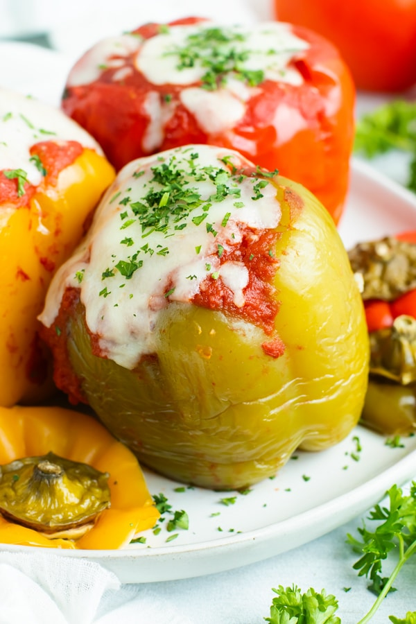Crock Pot stuffed peppers are loaded with lean ground turkey, cooked rice, and then topped with a flavorful tomato sauce for an easy and healthy weeknight dinner recipe.  Making this gluten-free stuffed bell peppers recipe in the slow cooker also makes clean-up a breeze!