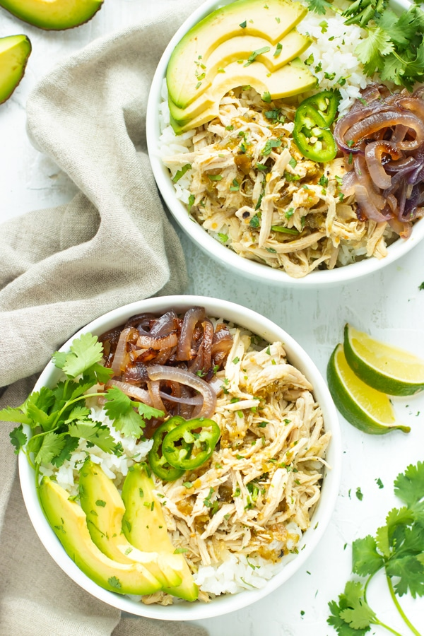 Slow Cooker Shredded Chicken Burrito Bowl Recipe in two white bowls.