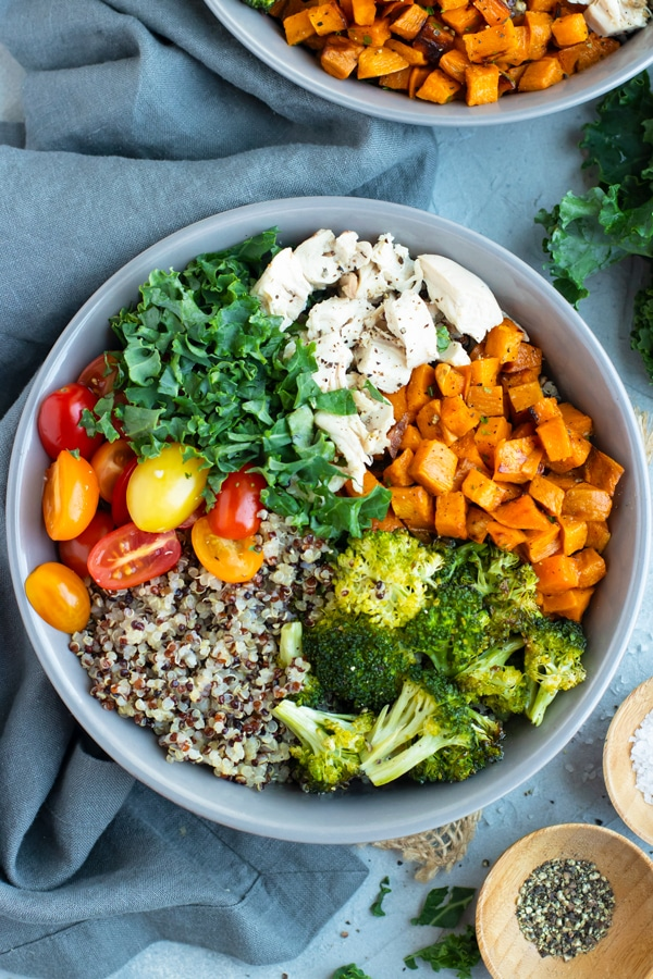 A gray bowl filled with a veggie quinoa bowl recipe.