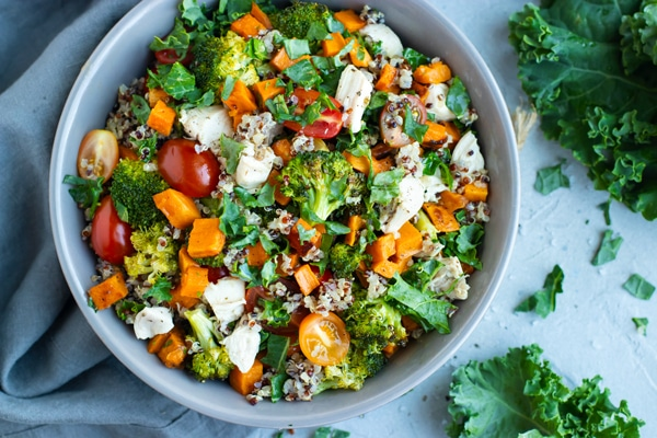 Chicken and veggie quinoa bowl in a gray bowl.