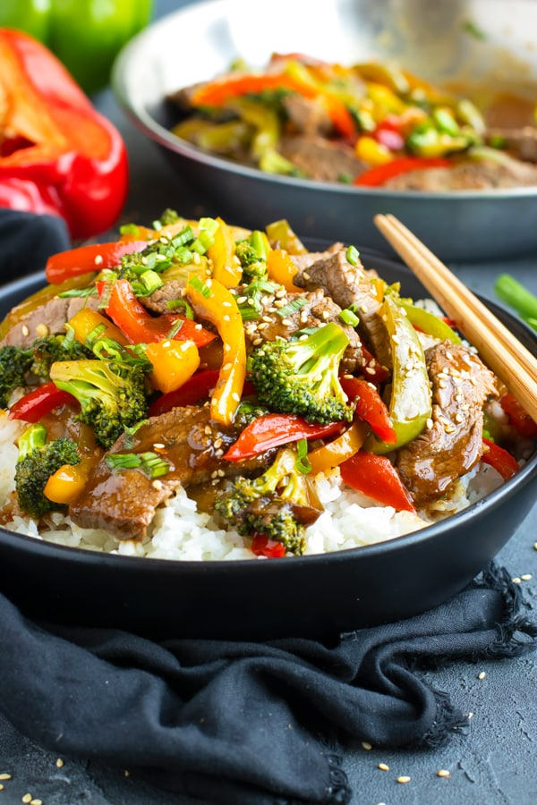 Delicious and healthy beef and broccoli stir fry in a bowl with chopsticks.