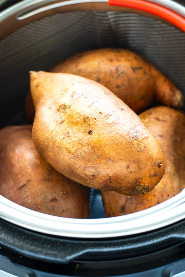 Sweet Potato in Ia pressure cooker with steamer basket.