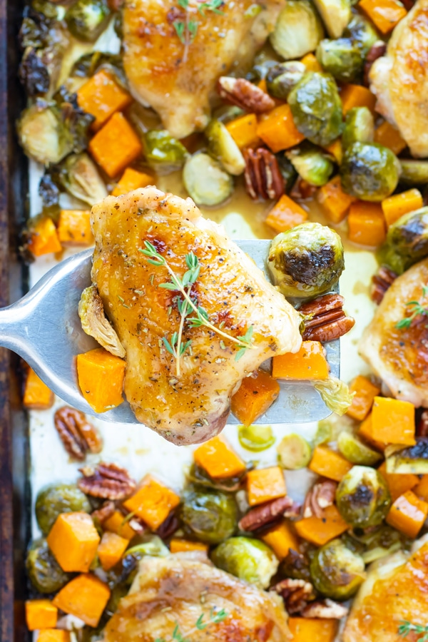One Pan Chicken and Veggies with scooped up maple glazed chicken.