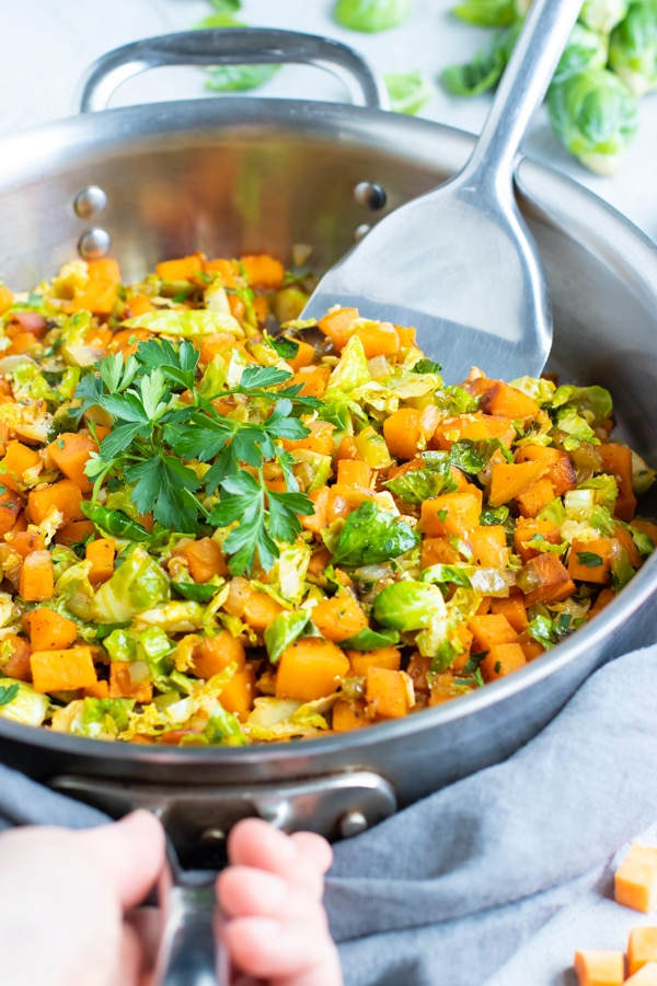 Skillet Brussel sprouts and sweet potatoes are a super quick and easy side dish to serve with chicken, steak, turkey, or pork! This healthy recipe is gluten-free, dairy-free, vegan, Paleo, and makes a great weeknight, Christmas, or Thanksgiving vegetable side dish, too!