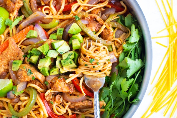 Easy and healthy fajita pasta recipe with a fork.