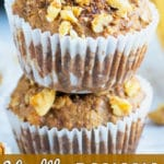 Two healthy banana muffins in a stack with other gluten-free and Paleo muffins around it.