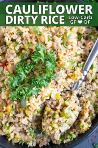 A large black bowl full of a low carb and keto dirty rice recipe.