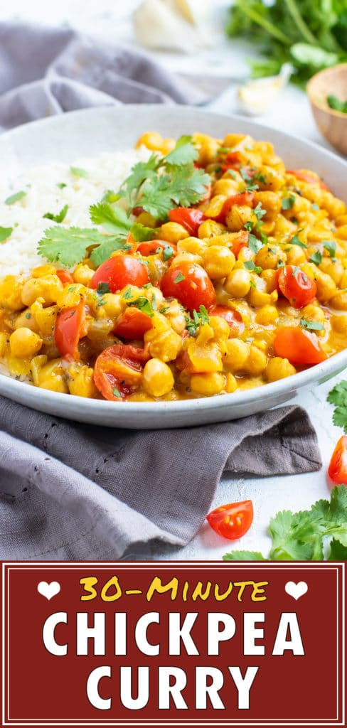 A large bowl full of an easy chickpea coconut curry with tomatoes.