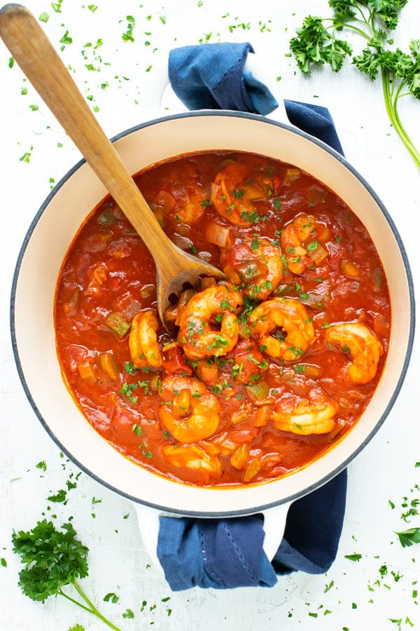A Dutch oven full of an easy Mardi Gras and Cajun recipe for Shrimp Creole.