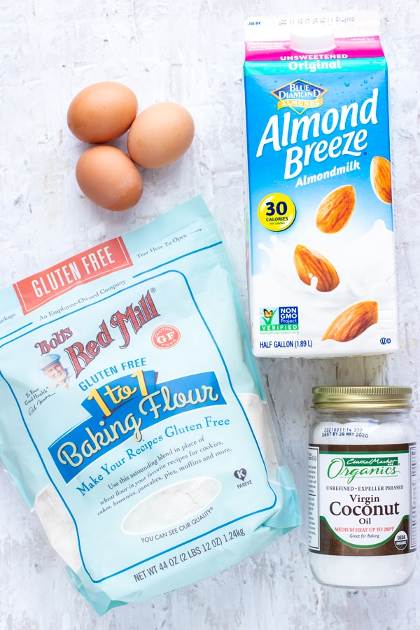 Almond milk, coconut oil, gluten-free flour, and three eggs as the ingredients for an easy pancake recipe.