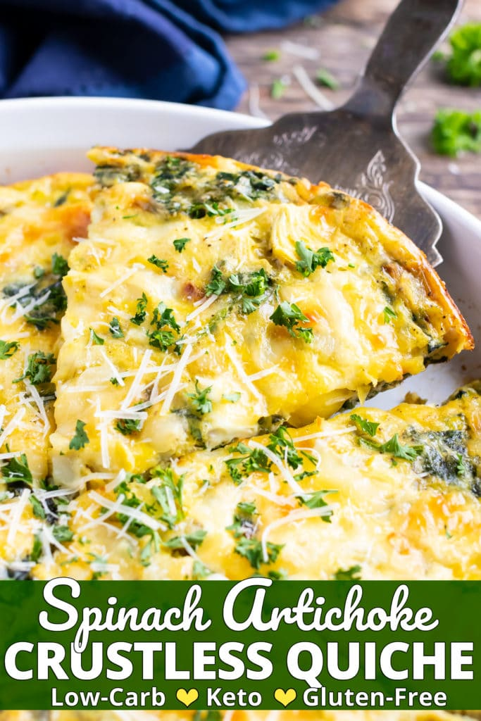 A slice of an egg bake recipe with spinach and cheese being picked up out of a casserole dish.