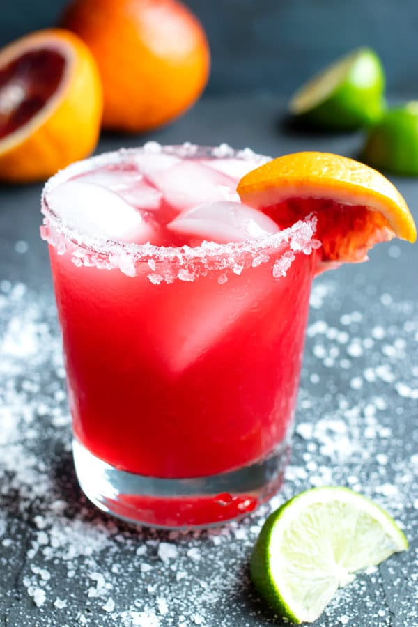 A homemade skinny margarita with a salted rim and a blood orange wedge for garnish.