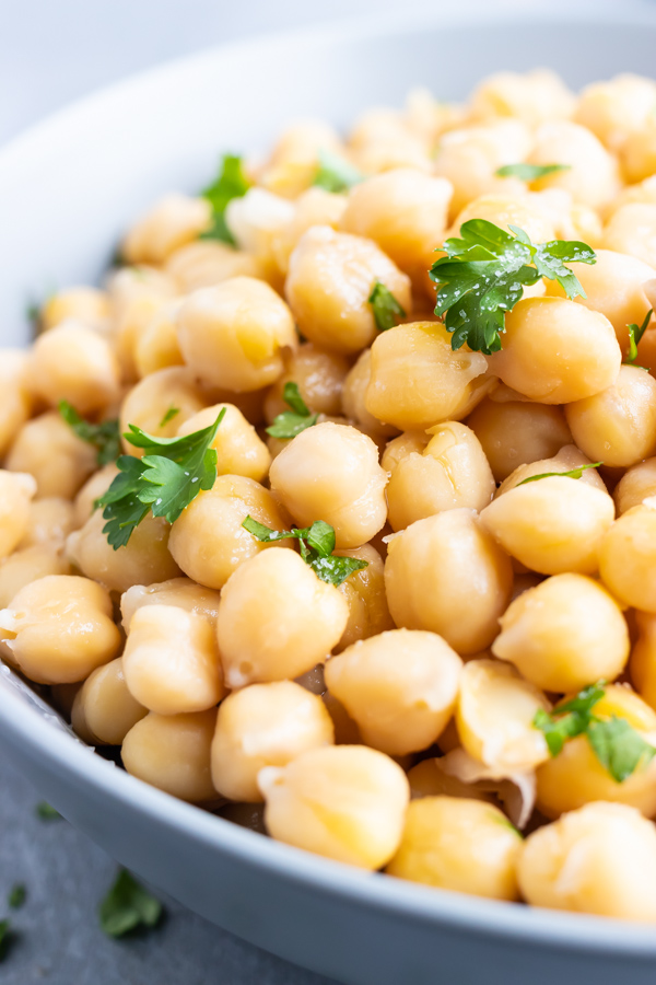 A close-up image of cooked chickpeas that were prepared on the stovetop.