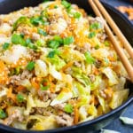 An easy and healthy keto dinner egg roll in a bowl recipe that is made of ground turkey or beef, cabbage, carrots, and Asian flavors.
