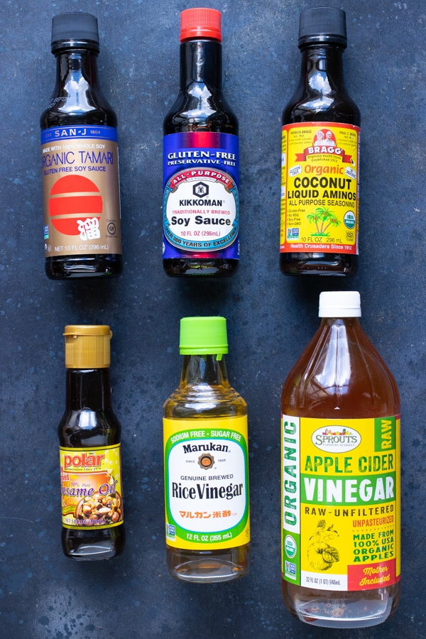 Different types of Tamari sauce, coconut aminos, soy sauce and vinegar for substitution ideas.