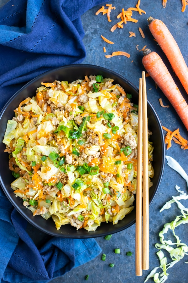 Keto and Paleo egg roll in a bowl dinner recipe with chopsticks and a blue napkin.