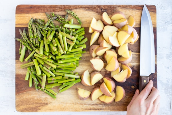 Chopped asparagus and red potatoes for a lemon garlic chicken breast recipe.
