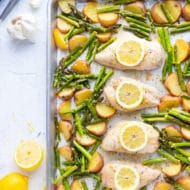 Lemon Garlic Chicken and Asparagus with Red Potatoes on a sheet pan.