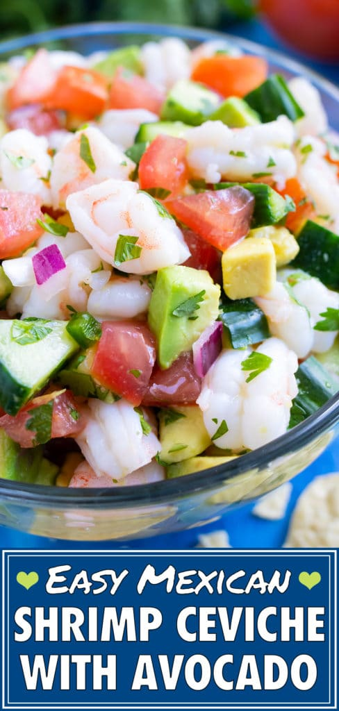 Bite-sized shrimp, avocado, cucumber, and tomato in a glass bowl.
