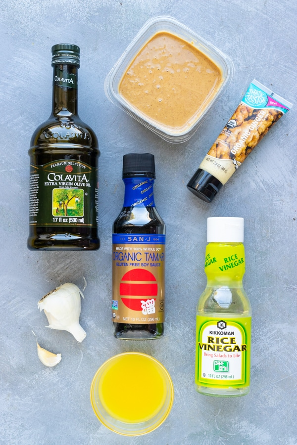 Olive oil, peanut butter, soy sauce, ginger, garlic, and rice vinegar as the ingredients for a Thai peanut dressing.