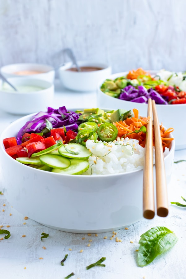 Rice bowl recipe made with Japanese sushi rice, avocado, cucumber, jalapeno, and carrots.