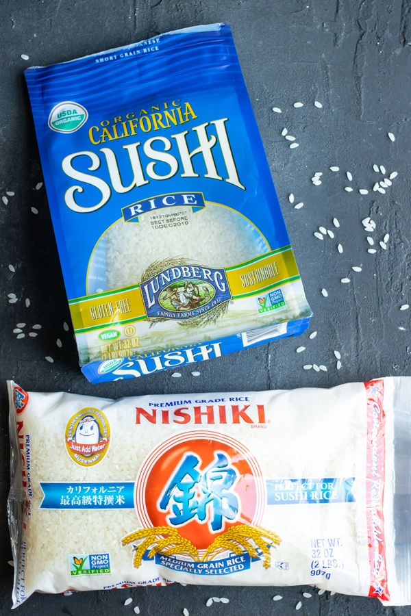 Two types of sushi rice brands: a bag of California short-grain sushi rice and a bag of Japanese medium-grain sushi rice.