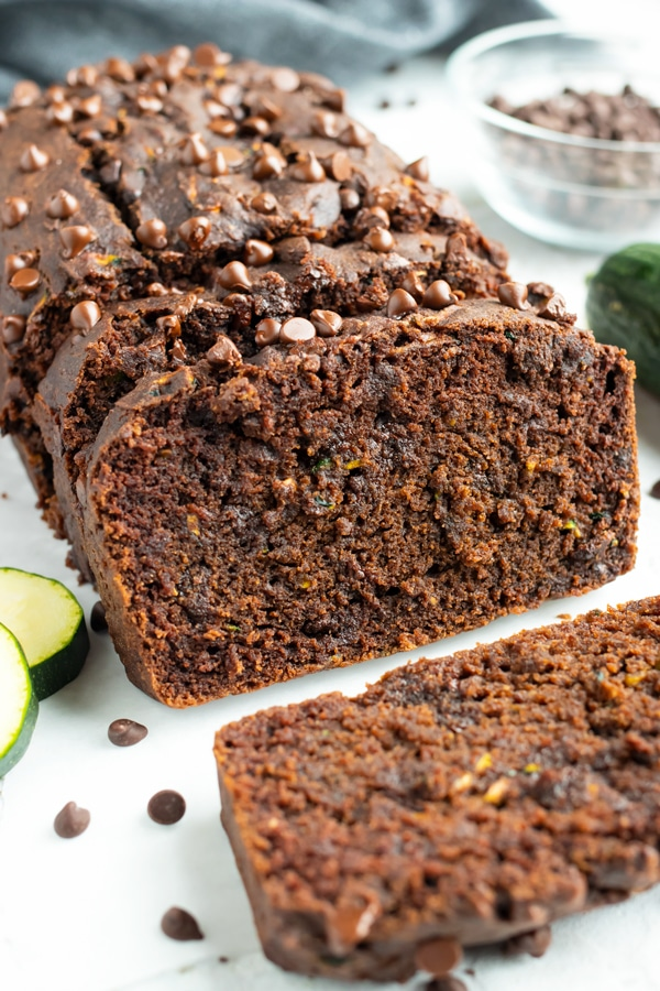 Chocolate Zucchini bread recipe with chocolate chips on a white table.
