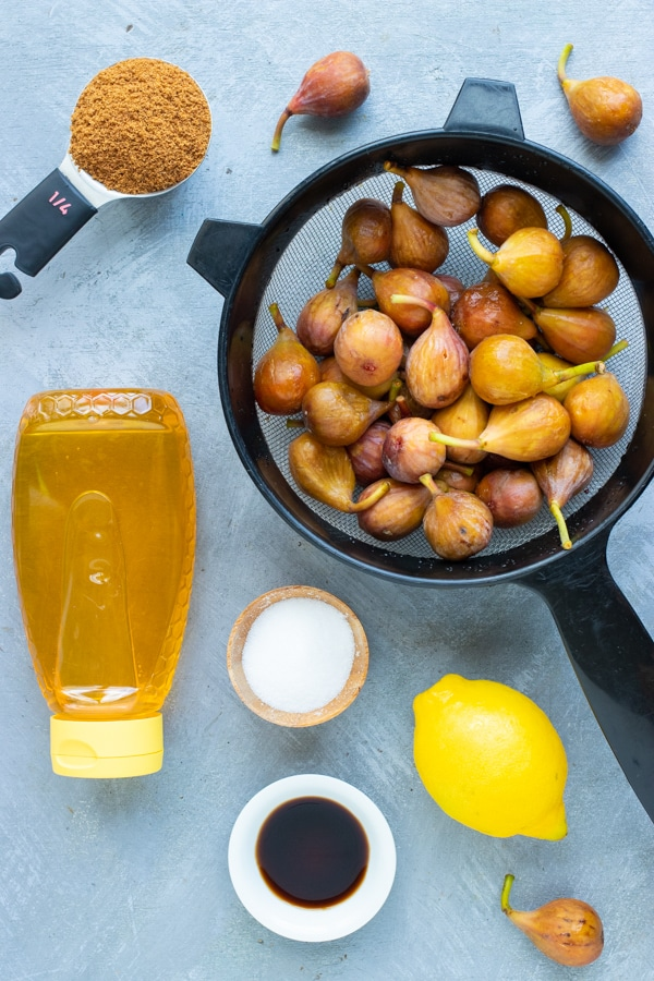 Figs, honey, coconut sugar, lemon juice, and vanilla as the ingredients in a homemade fig jam recipe.